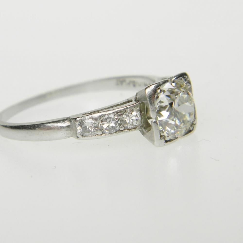 Art Deco Round Transitional Diamond in a Square Setting